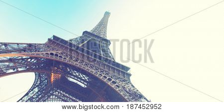 Angle shot of The Eiffel Tower in Paris, France. Retro style image. Copyspace composition