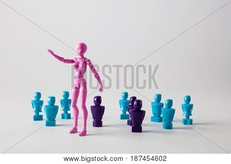 Female Leadership Concept Portrayed With Male And Female Figurines. Isolated On White With Copy Spac