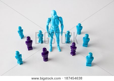 Strong Male Figurine Standing Among Faceles Lookalike Figurines. Search For Identity, Stand Out Of T