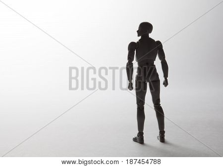 Male Figurine Silhouette Standing In Powerful Pose Looking To The Left On White Background With Copy