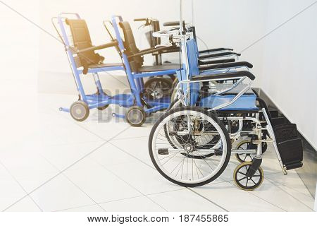 Empty wheelchair parked in hospital, close up