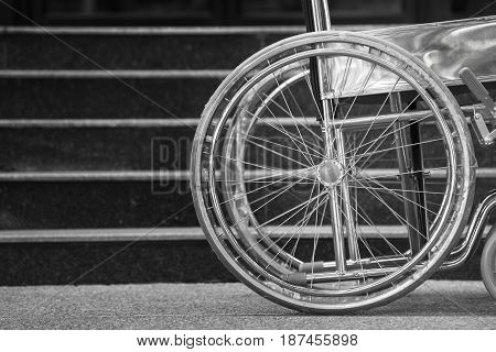Empty wheelchair parked in hospital black and white tone