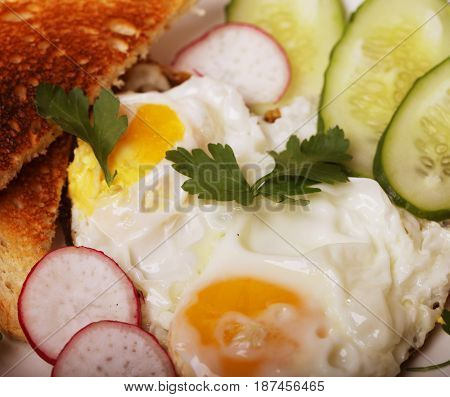 fried eggs and toast - excellent breakfast on white plate