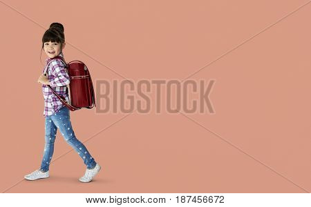Young asian kid student with a backpack portrait