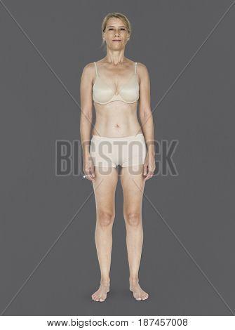 Caucasian Blonde Female Model On Gray Background
