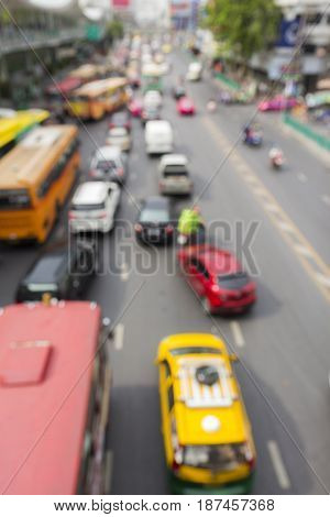blurred background of traffic in rush hour in ratchaprasong area Bangkok Thailand
