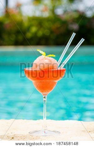 Frozen Strawberry Margarita Cocktail At The Edge Of A Resort Pool.  Concept Of Luxury Vacation