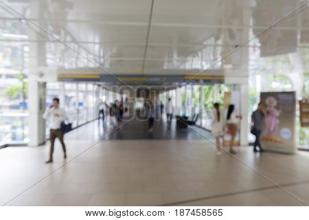 blurred background of people in walkway at ratchaprasong area Bangkok Thailand
