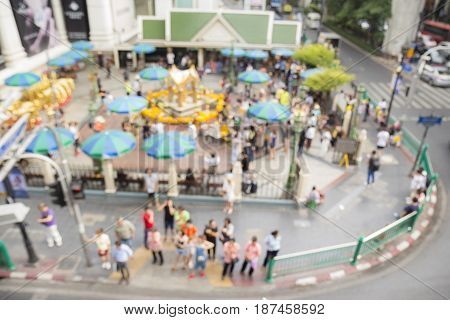 blurred background of top view of Erawan shrine at Ratchaprasong Junction in Bangkok Thailand.
