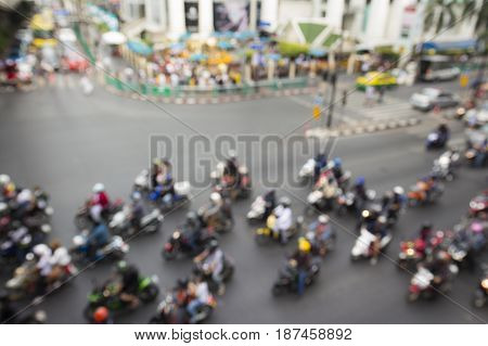 defocused scene of flow traffic at ratchaprasong junction in Bangkok Thailand