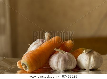 Still life of carrots with garlic in a rustic style