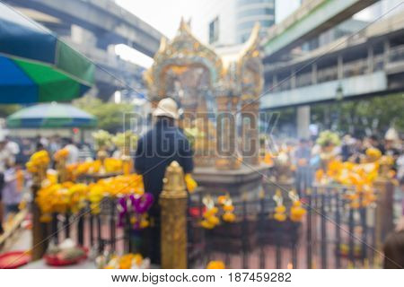 defocused scene of Erawan shrine in Ratchaprasong Junction in Bangkok Thailand. Erawan shrine is famous place in Ratchaprasong area