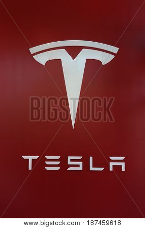 BROOKLYN, NEW YORK - MAY 21, 2017: Tesla Logo sign at the new Tesla dealership at Red Hook in Brooklyn, New York