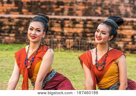 KALASIN THAILAND - FEBRUARY 20 2016: Girl dancers with local dress doing Thai Northeastern traditional dance at Yaku Pagoda to celebrate Buddism event in Kalasin