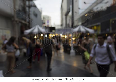 defocused scene of unidentified people at siam square in Bangkok Thailand