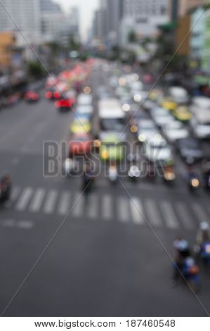 defocused scene of car in red light signal on traffic in Bangkok Thailand