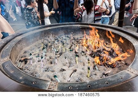 Tokyo Japan - May 1 2017: Tourists and Local are worshiping the shrine through the incense in Sensoji Shrine.