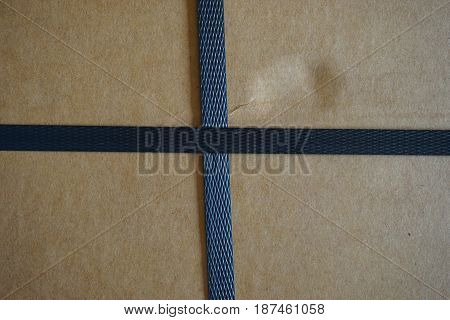 abstract line of black straps on the carton box