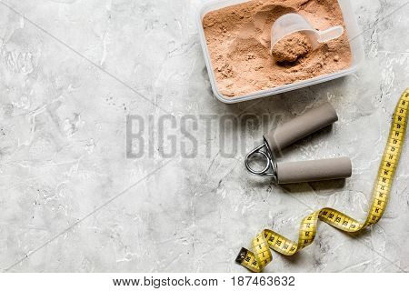 Sport and diet nutrition with equipment on stone background top view space for text