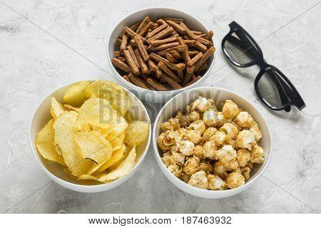 glasses, snacks, beer for whatchig film on stone desk background