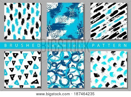 Vector Set of seamless pattern with brush stripes and strokes. Black blue color on white background. Hand painted grange texture. Ink geometric elements. Fashion modern style. Endless fabric retro print.