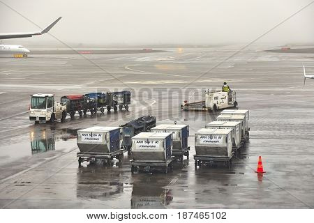 HELSINKI, FINLAND - APRIL 1, 2017: Air cargo unit load devices at Helsinki Internation Airport. Foggy, rainy weather.