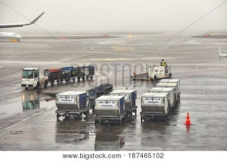 HELSINKI, FINLAND - APRIL 1, 2017: Air cargo unit load devices at Helsinki Internation Airport. Foggy, rainy weather.