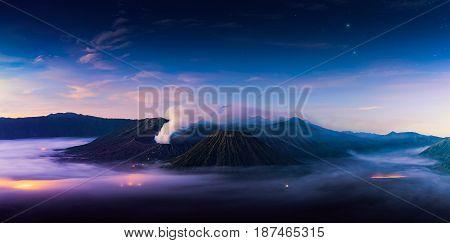 Mount Bromo volcano (Gunung Bromo) during sunrise from viewpoint on Mount Penanjakan. Mount Bromo located in Bromo Tengger Semeru National Park East Java Indonesia. twilight