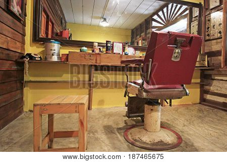 BANGKOK-THAILAND : MAY 18 2017 Old red chair in barber decoration at Baan Bangkhen museum
