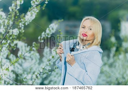 Pretty Girl With Red Lips And Blonde Hair In Blossom
