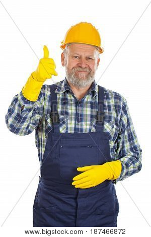 Picture of an elderly plumber wearing yellow helmet and gloves showing thumbs up