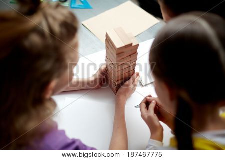High angle portrait of children playing board game at table in child development center