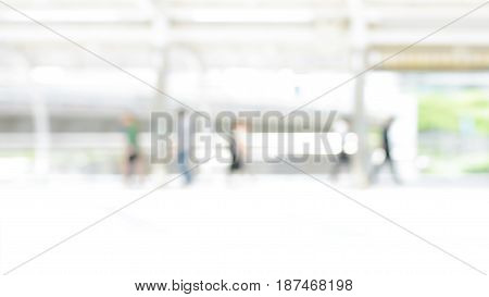 Blur image of covered walkway with people in the city - abstract background 16:9 proportion