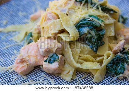Tagliatelle With Salmon And Spinach. Italian Pasta