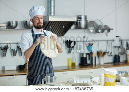 Chef with flatbread cooking at workplace