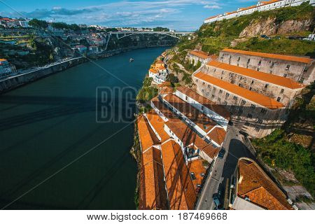 Douro river and coast of Vila Nova de Gaia from Dom Luis I bridge, Porto, Portugal.