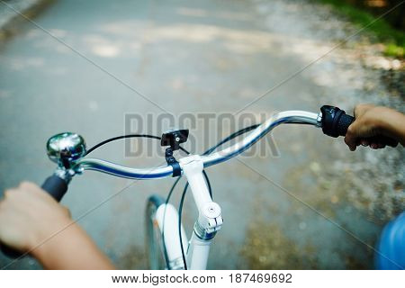 Hands of cyclist on handles during ride