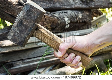 hand of a man with a large hammer