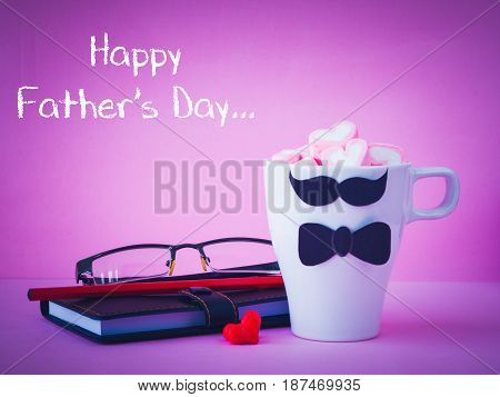 Father's day concept. Happy father's day text with black paper of face and Mustache on pink background