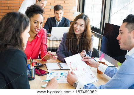 Multiethnic business people having a meeting in co-working space