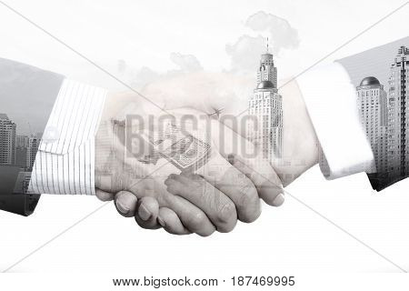 Handshake of businessmen on white background double exposure effect - partnership merger and acquisition concepts