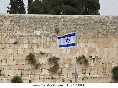 Israeli Flag in front of the Western Wall in the Old City of Jerusalem.