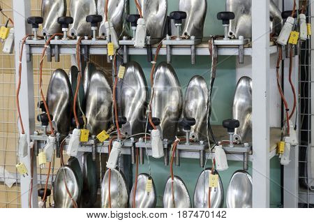 A rack with aluminum shoe pads. Modern footwear production.