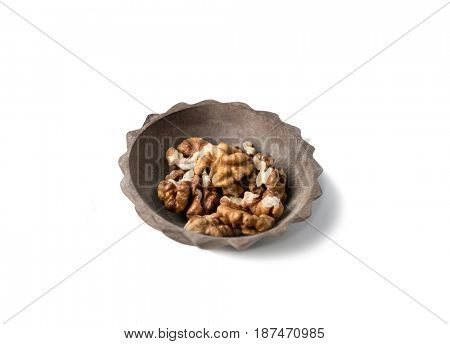 Small saucer with peeled walnuts ready to eat, healthy and rich source of protein