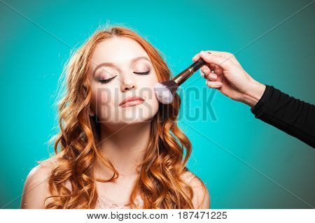 Beauty mater making make-up. Professional skin care.