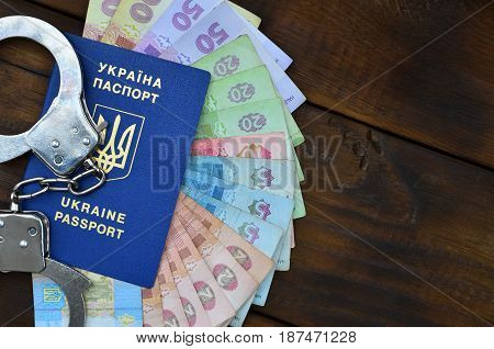 A Photograph Of A Ukrainian Foreign Passport, A Certain Amount Of Ukrainian Money And Police Handcuf