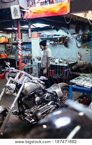 Young specialist working as bike service technician