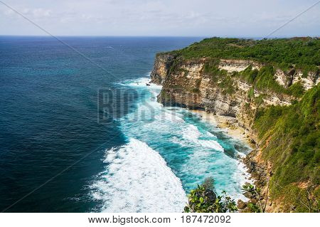 The cliffs and the ocean near the Uluwatu Temple on Bali, Indonesia.