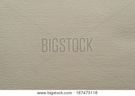 abstract grained texture of speckled fabric or paper material of pale color sepia