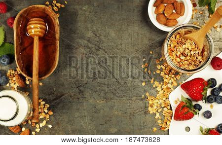 Granola. Breakfast set with granola, almond milk, honey and berries. Healthy eating concept. Copy space background, top view flat lay overhead